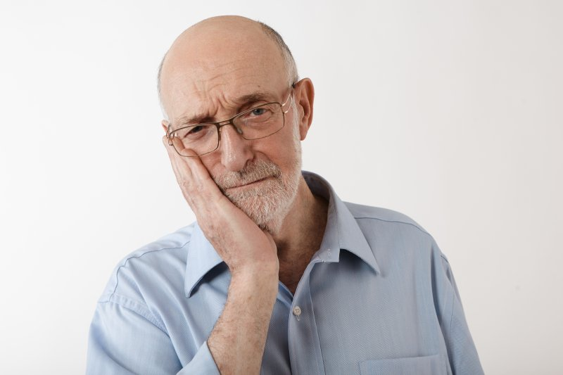 older man experiencing dental implant tooth sensitivity in rockville