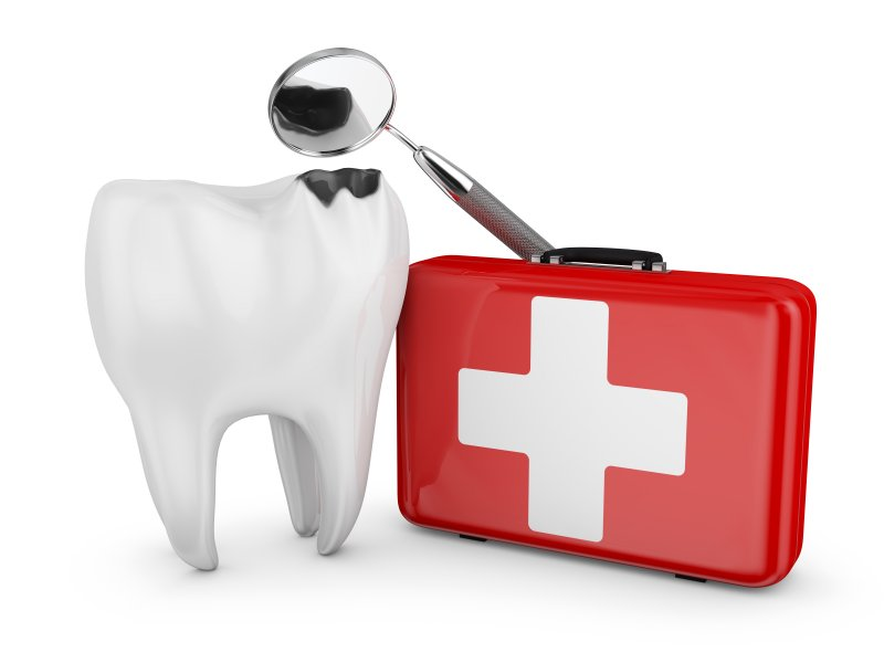 Decayed tooth and medical kit representing dental emergencies